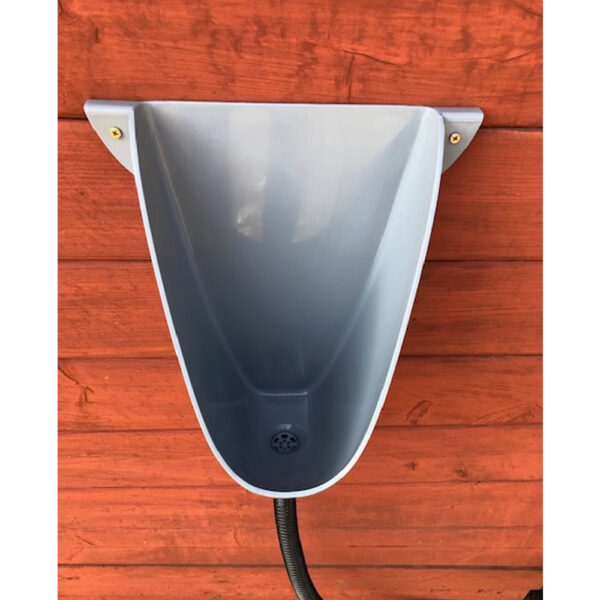 Front shot of waterless urinal installed on shed wall